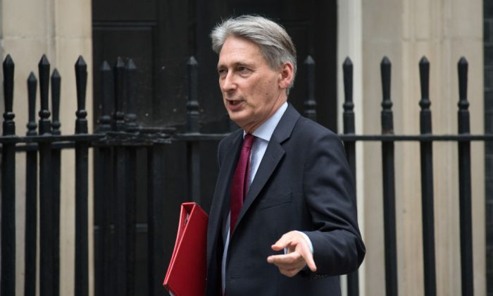 Chancellor of the Exchequer Philip Hammond, leaves after a meeting of business leaders hosted by Prime Minister Theresa May, ahead of her Brexit update to the House of Commons, on Oct. 9, 2017. (Carl Court/Getty Images)