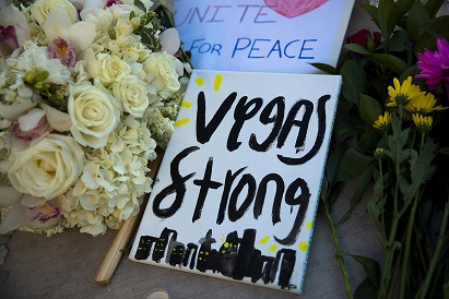 A makeshift memorial for the victims of the mass shooting on Oct. 1 stands at an intersection on the north end of the Las Vegas Strip, Oct. 3, 2017 in Las Vegas, Nevada. Increasing secularization may make mass shootings more likely. (Drew Angerer/Getty Images)