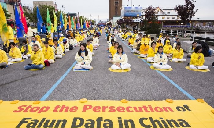 Falun Gong practitioners at a demonstration near the Chinese consulate in New York City on May 12, 2017. (Samira Bouaou/The Epoch Times)