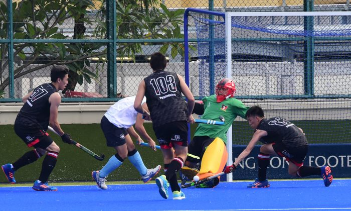 Valley-A are forced to defend in their HKHA Premier League match at HKFC on Sunday Oct 8. After a hard fought match HKFC came away 4-0 winners. (Bill Cox/Epoch Times)