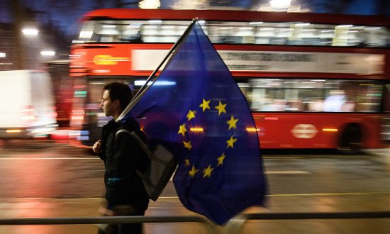 A man carries a European Union flag outside the Supreme Court in Parliament Square ahead of the ruling on whether Parliament have the power to begin the Brexit process in London on Jan. 24, 2017. (Leon Neal/Getty Images)