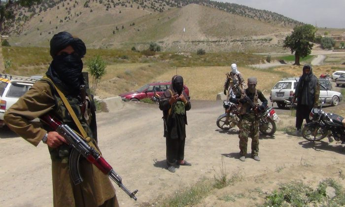 Afghanistan's Taliban militia stand with their weapons in Ahmad Aba district on the outskirts of Gardez, the capital of Paktia province, on July 18, 2017. (Faridullah Ahmadzai/AFP/Getty Images)