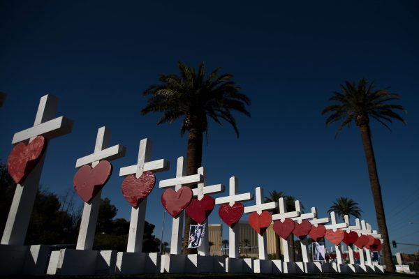 Fifty-eight white crosses for the victims of Sunday night's mass shooting stand on the south end of the Las Vegas Strip, October 5, 2017 in Las Vegas, Nevada. (Drew Angerer/Getty Images)