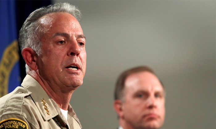 FILE PHOTO - Clark County Sheriff Joe Lombardo responds to a question during a media briefing at the Las Vegas Metro Police headquarters in Las Vegas, Nevada, U.S. October 3, 2017. Aaron Rouse, FBI Special Agent in Charge of the Las Vegas Division, looks on at right. (Reuters/Las Vegas Sun/Steve Marcus)