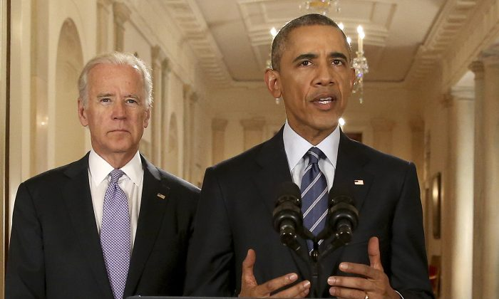 Former President Barack Obama, standing with Former Vice President Joe Biden, talks about the Iran Nuclear Deal on July 14, 2015. (Andrew Harnik-Pool/Getty Images)