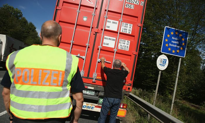 German police inspect a truck entering Germany at the border to Austria on Sept. 15, 2015 near Freilassing, Germany. (Sean Gallup/Getty Images)