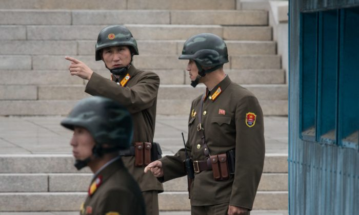 A North Korean soldier gestures before the military demarcation line separating North and South Korea at the truce village of Panmunjom on Oct. 12, 2017. (AFP/Getty Images)