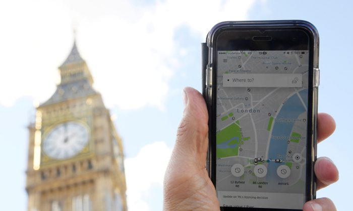 A photo illustration shows the Uber app on a mobile telephone, as it is held up for a posed photograph in central London, Britain Sept. 22. (REUTERS/Toby Melville/File Photo)