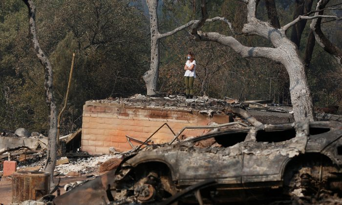 Pamela Garibaldi Looks Over Burned Remains Of Her Parents Home Destroyed By Wildfire In Napa California Oct 13 REUTERS Jim Urquhart
