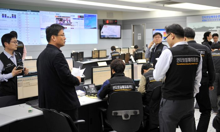 In this file photo, members of the Korea Internet Security Agency (KISA) check on cyberattacks at a briefing room in Seoul on March 20, 2013. South Korea is scrambling to patch up vulnerabilities in cyberspace, after a shocking report that North Korean hackers had stolen a large cache of military documents in 2016. (Jung Yeon-Je/AFP/Getty Images)