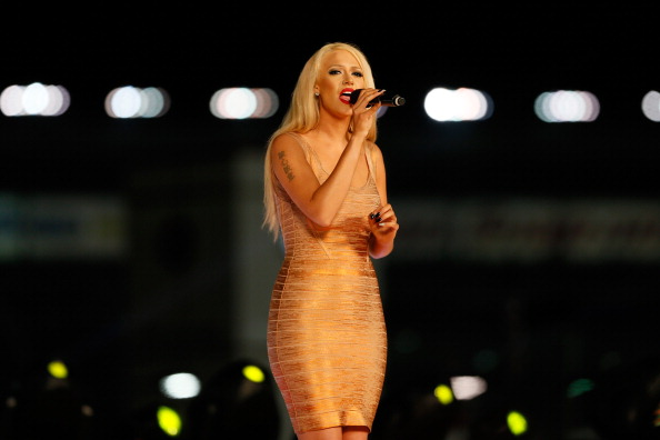 Kaya Jones sings the natinoal anthem during pre-race ceremonies for the NASCAR Sprint Cup Series All-Star race at Charlotte Motor Speedway on May 18, 2013 in Concord, North Carolina.  (Kevin C. Cox/Getty Images)