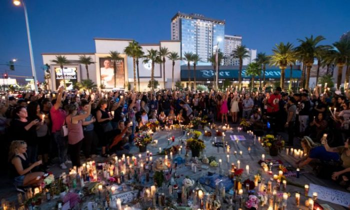 Mourners attend a vigil to mark one week since the mass shooting at the Route 91 Harvest country music festival, at the corner of Sahara Avenue and Las Vegas Boulevard at the north end of the Las Vegas Strip, on Oct. 8, 2017 in Las Vegas.  (Drew Angerer/Getty Images)