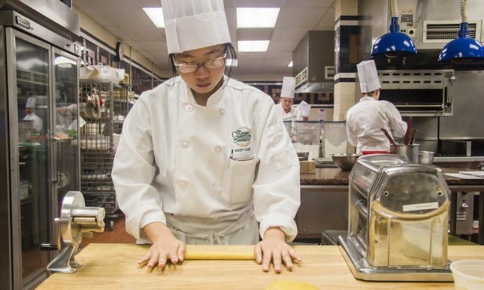 Reporter Annie Wu learns to make fresh pasta for a cavatelli dish at the CIA's Italian boot camp in Hyde Park, N.Y., on July 27. (Pruitt Kerdchoochuen)