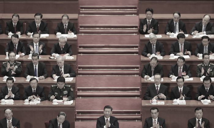 Chinese leader Xi Jinping (center) and top leaders attend a party summit, the  National People's Congress, in Beijing on March 15, 2017.  (Photo by Lintao Zhang/Getty Images)