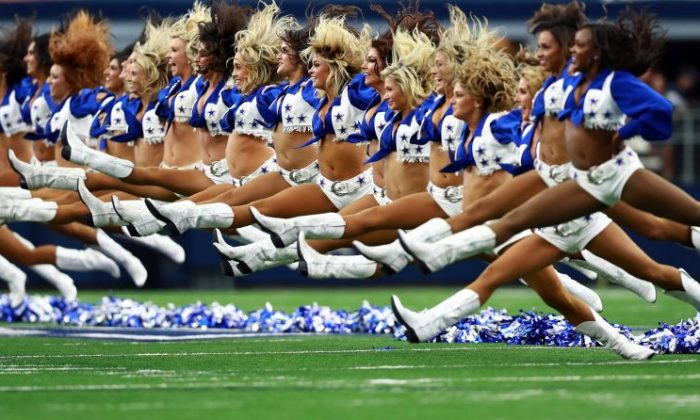 The Dallas Cowboys Cheerleaders perform before the Dallas Cowboys take on the Green Bay Packers at AT&T Stadium in Arlington, Texas, on Oct. 8, 2017. (Tom Pennington/Getty Images)