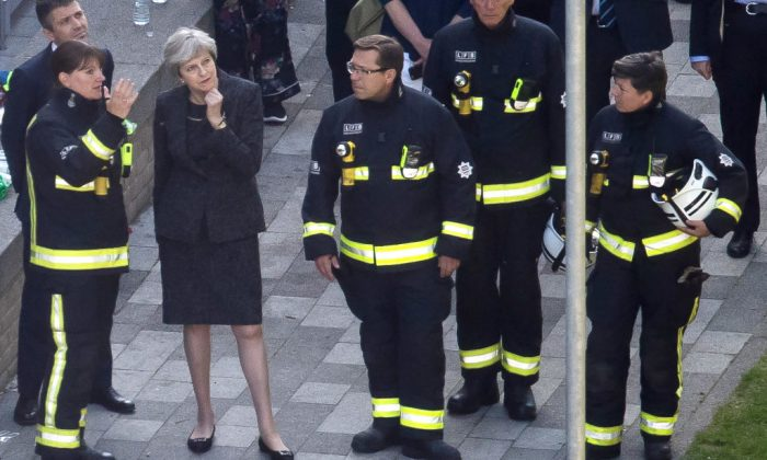 Dany Cotton, Commissioner of the London Fire Brigade, speaks to Prime Minister Theresa May as she visits Grenfell Tower, on June 15, 2017 in London. (Dan Kitwood/Getty Images)