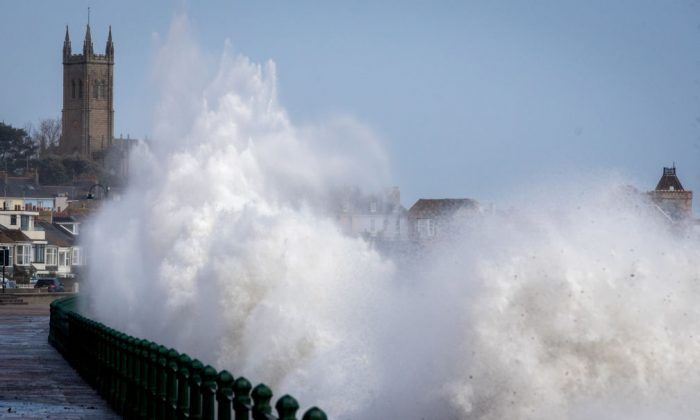Waves whipped up by Hurricane Ophelia crash over the seafront in Penzance in Cornwall, England, on Oct. 16, 2017. Hurricane Ophelia comes exactly 30 years after the Great Storm of 1987. (Matt Cardy/Getty Images)