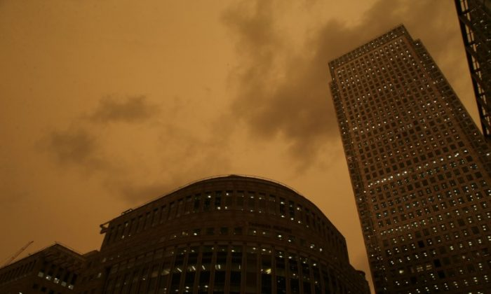 The sky turns red over buildings in Canary Wharf as dust from the Sahara carried by storm Ophelia filters sunlight over London, Oct. 16, 2017. (Tom Jacobs/Reuters)