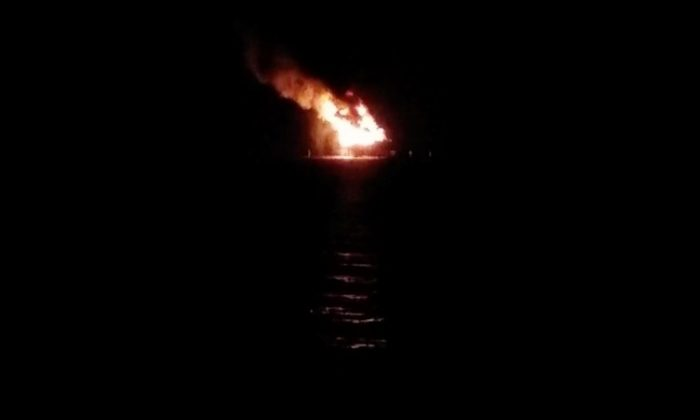 Flames are seen after an explosion at an oil rig in Lake Pontchartrain, in Louisiana, in this still image taken from social media video taken October 15, 2017. (Roger Fernandez/via REUTERS)