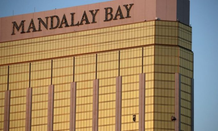 Drapes billow out of broken windows at the Mandalay Bay resort and casino on the Las Vegas Strip, following a deadly shooting at a music festival in Las Vegas on Monday, Oct. 2, 2017. (AP Photo/John Locher, File)