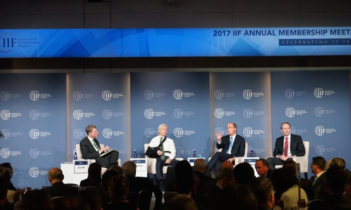 (L–R) Tim Adams, president and CEO of the Institute of International Finance (IIF), Jamie Dimon, chairman and CEO of JPMorgan Chase, Laurence Fink, chairman and CEO of BlackRock, and James Gorman, chairman and CEO of Morgan Stanley, at a panel discussion during the annual meeting of the IIF in Washington on Oct. 13, 2017. (Courtesy of IIF)