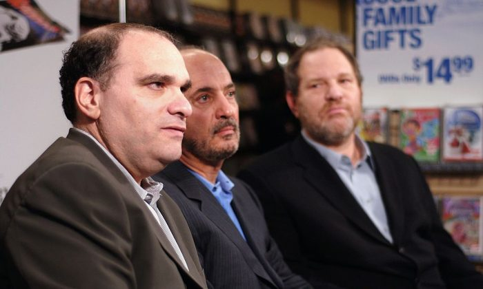 (L-R) Bob Weinstein,  Blockbuster Chairman and CEO, John Antioco, and Harvey Weinstein speak with reporters at a press conference announcing The Weinstein Company's deal with Blockbuster  Inc. for exclusive rights to rent theatrical movies and direct-to-video titles at Blockbuster in New York City, New York, on Nov. 15, 2006. (Andrew H. Walker/Getty Images)