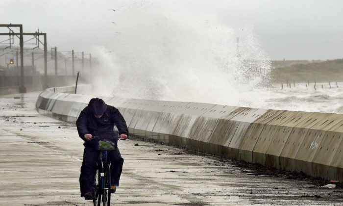Waves crash over the breakwater as the remnants of Hurricane Ophelia hit Saltcoats on the west coast of Scotland on the morning of Oct. 17, 2017. (Andy Buchanan/AFP/Getty Images)