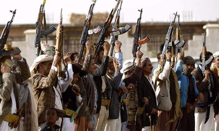 Yemen's Shiite Houthi rebels shout slogans during a gathering to mobilize more fighters to battlefronts to fight pro-government forces, on June 18, 2017, in the capital Sanaa.(Mohammed Huwais/AFP/Getty Images)