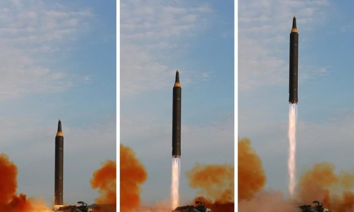 The Hwasong-12 missile in this undated combination photo released by North Korea's Korean Central News Agency (KCNA) on September 16, 2017. A Hwasong-12 flew over Hokkaido, the second largest island of Japan, on a North Korean test launch on Sept 15. (KCNA via Reuters)