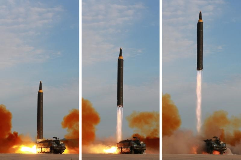 The Hwasong-12 missile in this undated combination photo released by NorthKorea's Korean Central News Agency (KCNA) on September 16, 2017. A Hwasong-12 flew over Hokkaido, the second largest island of Japan, on a North Korean test launch on Sept 15. KCNA via REUTERS