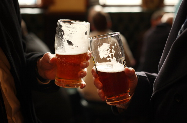 Drinkers enjoy a pint in a pub. (Photo by Peter Macdiarmid/Getty Images)