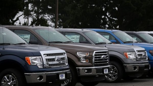 New Ford F-150 pickups are displayed on the sales lot at Serramonte Ford on April 28, 2015 in Colma, California. (Justin Sullivan/Getty Images)