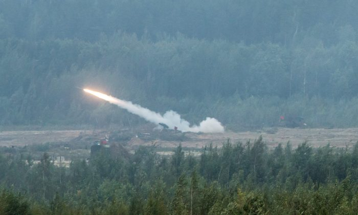 A rocket is launched as part of the Zapad 2017 military exercises at the Asipovichy military training ground on Sept. 18, 2017, in in Asipovichy, Belarus. (Brendan Hoffman/Getty Images)