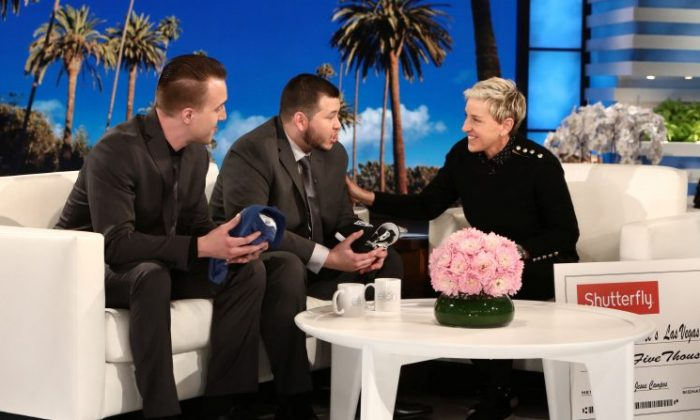 """Stephen Schuck and security guard Jesus Campos of the Mandalay Bay Resort and Casino in Las Vegas, are interviewed by host Ellen DeGeneres during the taping of  """"The Ellen DeGeneres Show"""" in Burbank, California in this photo released on Oct. 18, 2017. (Michael Rozman/Warner Bros./Handout via REUTERS)"""
