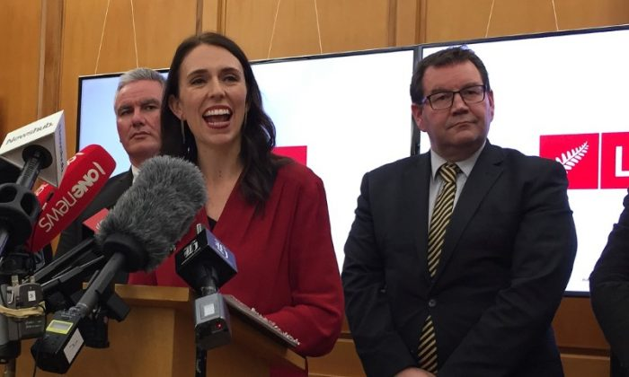 New Zealand Labour leader Jacinda Ardern smiles as she speaks to the press after leader of New Zealand First party Winston Peters announced his support for her party in Wellington, New Zealand, October 19, 2017.   (REUTERS/Charlotte Greenfield)