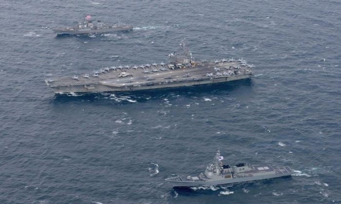The Navy's forward-deployed aircraft carrier USS Ronald Reagan and the forward-deployed Arleigh Burke-class destroyer USS Stethem steam alongside ships from the Republic of Korea Navy in the waters east of the Korean Peninsula on October 18, 2017. Picture taken on October 18, 2017. (Kenneth Abbate/U.S. Navy/Handout via REUTERS)
