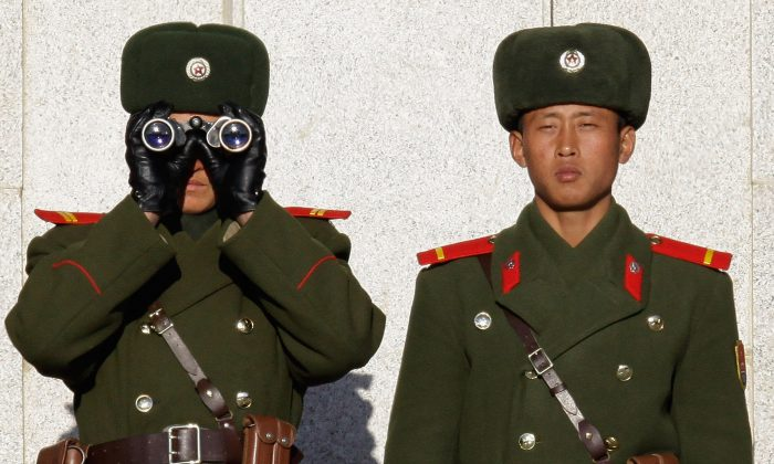 North Korean soldiers look at South Korea across the Koreand Demilitarized Zone on Dec. 22, 2011. (Chung Sung-Jun/Getty Images)