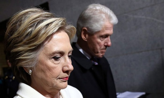 Former Democratic presidential nominee Hillary Clinton (L) and former President Bill Clinton arrive on the West Front of the U.S. Capitol in Washington on Jan. 20, 2017. (Win McNamee/Getty Images)