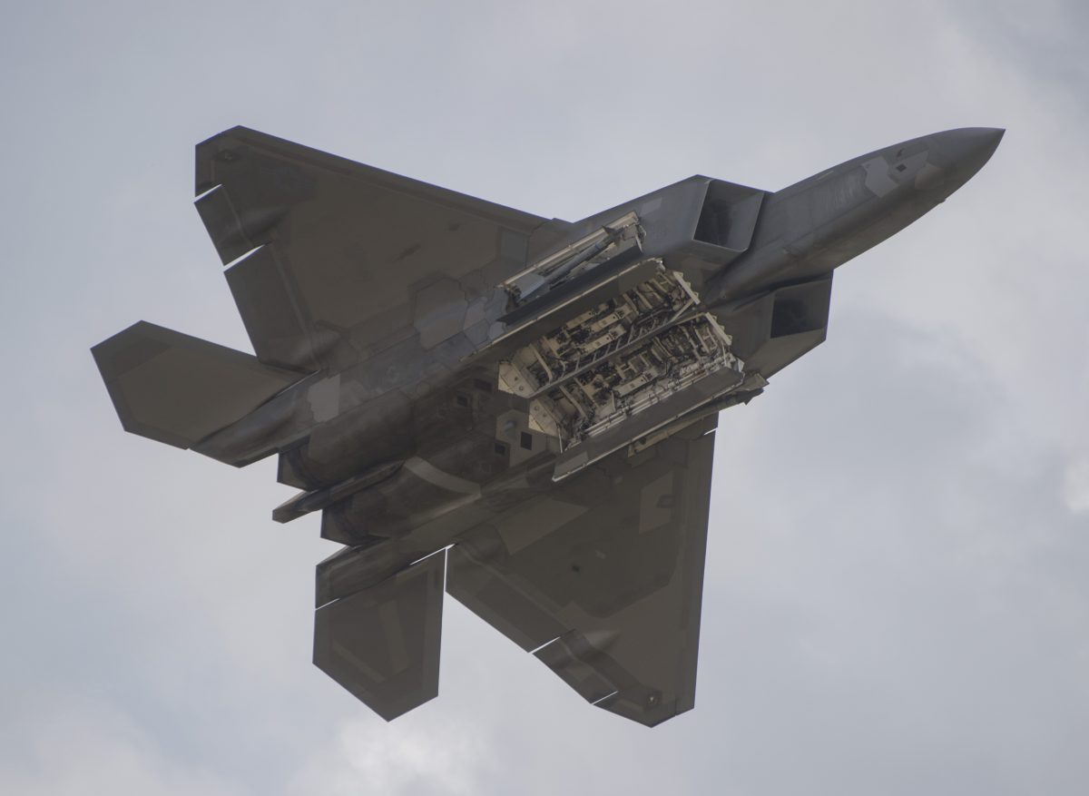 An F-22 Raptor shows the internal bays as it does a fly-by during the airshow at Joint Andrews Air Base in Maryland on September 16, 2017. ( Andrew Caballero-Reynolds/AFP/Getty Images)