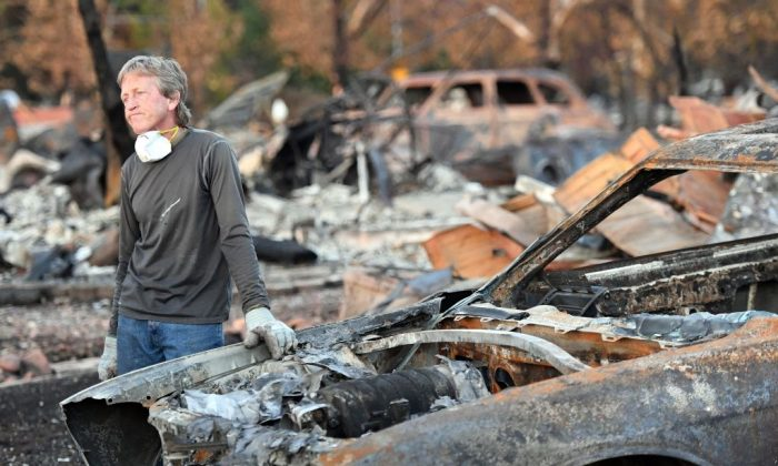 Car collector Gary Dower speaks with neighbors at his fire-destroyed home in Santa Rosa, Calif., on Oct. 20, 2017.  (Josh Edelson/AFP/Getty Images)