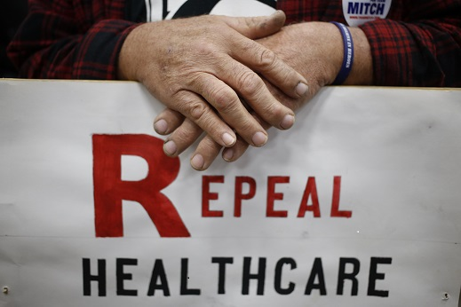 James Hughes of Louisville, Ky. holds a sign calling for the repeal of the Affordable Care Act during a rally for Senate Mitch McConnell (R-Ky.) in Louisville, Kentucky on Oct. 31, 2014. (Luke Sharrett/Getty Images)