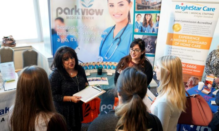 Job seekers listen to a recruiter at the Colorado Hospital Association job fair in Denver, Colo.,  on Oct. 4, 2017.  (REUTERS/Rick Wilking/File Photo)