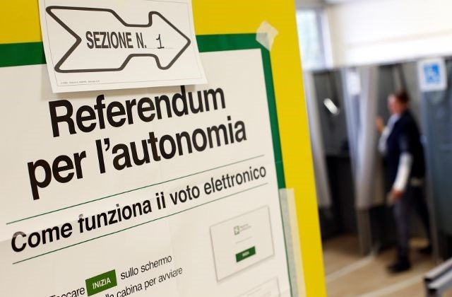 A poster with instructions about Lombardy's autonomy referendum is seen at a polling station in Lozza near Varese, northern Italy, October 22, 2017.  (Reuters/Alessandro Garofalo)