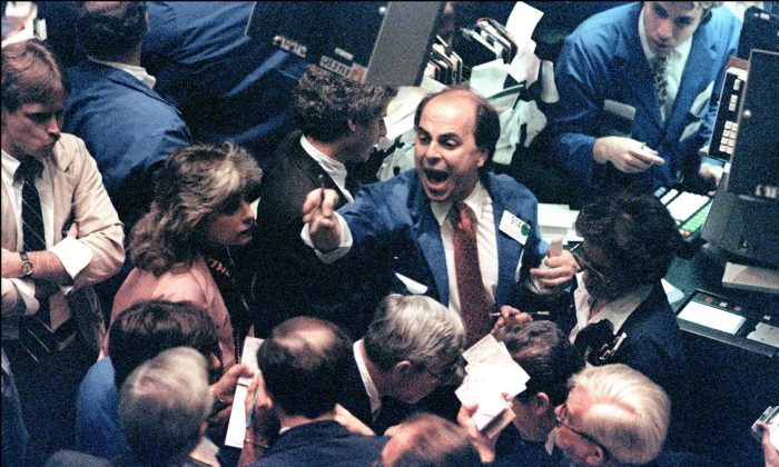 A trader shouts orders on the New York Stock Exchange in this file photo. While markets have cooled a bit, investors are too confident markets will continue to rise. (MARIA BASTONE/AFP/Getty Images)