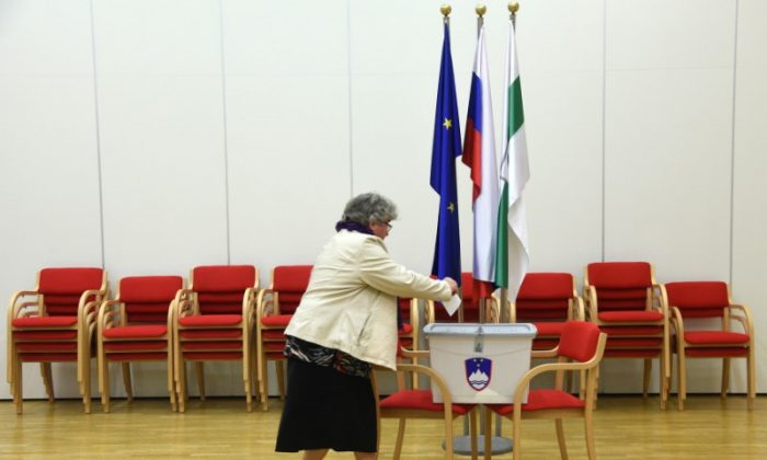 A woman casts her vote at a polling station during the presidential election in Grosuplje, Slovenia Oct. 22, 2017. (REUTERS/Borut Zivulovic)