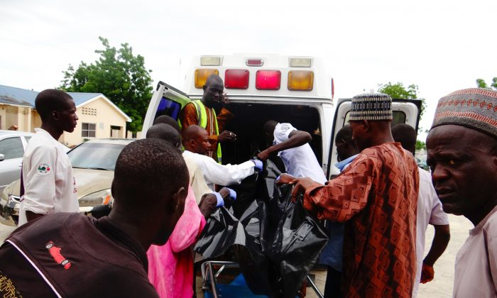 A victim is brought to the State Specialist Hospital in Maiduguri, northeastern Nigeria on July 29, 2017–the day after two suicide bombers struck a camp for displaced people in Dikwa, 90 kilometres (56 miles) east of Maiduguri, killing five. Civilian militia member Babakura Kolo said the attackers disguised themselves as traders wanting to buy grain. (STRINGER/AFP/Getty Images)