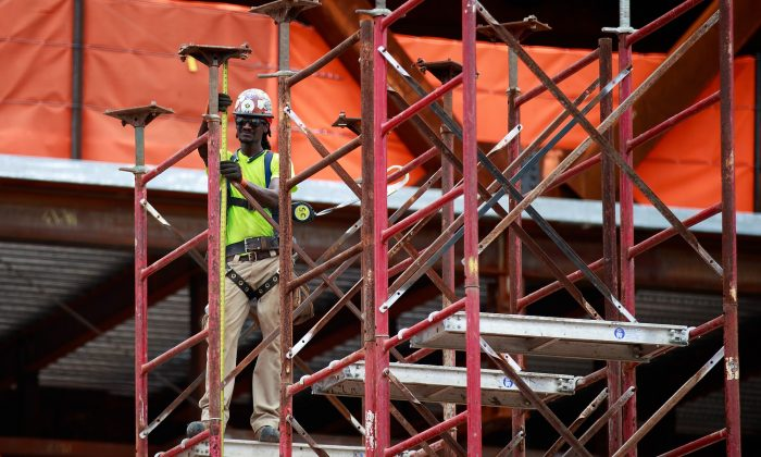 A construction laborer works on the site of a new residential building in the Hudson Yards development in New York on Aug. 22, 2017. (Drew Angerer/Getty Images)