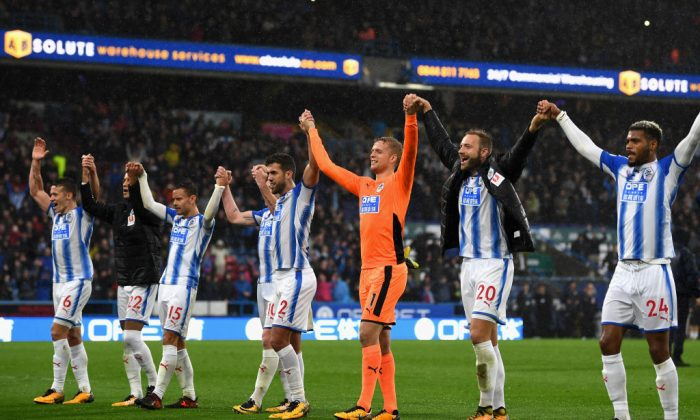 Huddersfield Town players celebrate after winning the Premier League match between Huddersfield Town and Manchester United at John Smith's Stadium on Oct 21, 2017 in Huddersfield, England. (Gareth Copley/Getty Images)