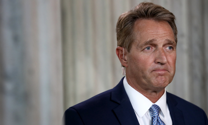 Sen. Jeff Flake speaks to reporters on Capitol Hill after announcing he will not seek re-election on Oct. 24, 2017. (Win McNamee/Getty Images)