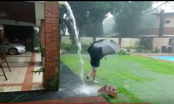 A boy in northwest Argentina has a close brush with death when lightning strikes in his backyard as he's playing in the rain. (Youtube/MIsiones Online)